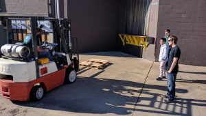 Peninsula Catholic High School Students from Foundations in Engineering STEM Program - Learning about using a Fork Lift