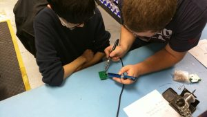 Peninsula Catholic High School Students from Foundations in Engineering STEM Program - Learning about Soldering